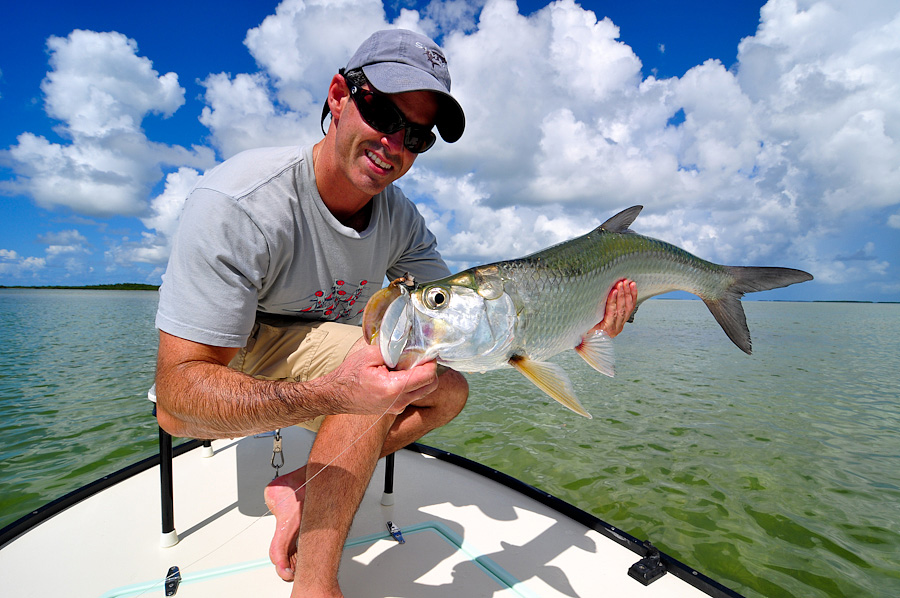 Angler with Baby Tarpon ©Ross Reeder 2011