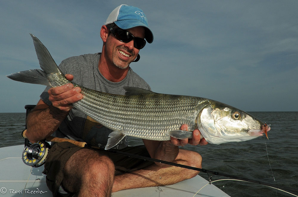 Angler with Bonefish ©Ross Reeder 2011