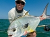 Angler with Permit on Fly ©Ross Reeder 2011