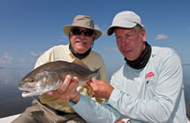 Dave Denkert fishes for redfish with Chico Fernandez