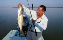 Mitch Howell catches a snook with Captain Dave Denkert